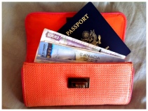 I keep my passport (or a copy) inside an oversized wallet.