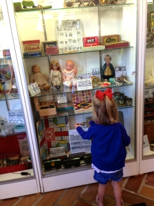 Chloe wishes she could play with the antique toys.