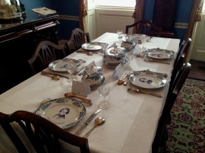 The dining room is set with flatware of other notable authors.