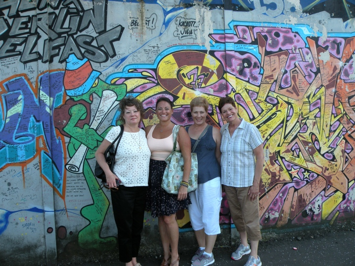 With her aunt and friends at the Peace Wall, Belfast Northern Ireland.