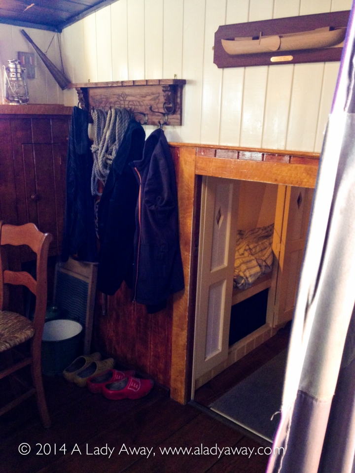 Small living space and sleeping enclosure at the stern of the boat.