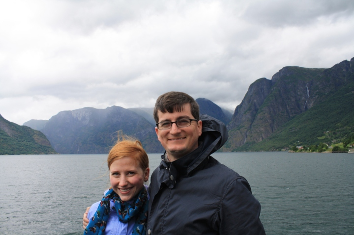 Julie and her husband, Chris, aboard a boat on a Norwegian fjord.