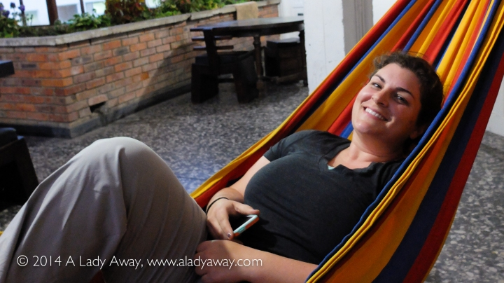 Relaxing in the hammock on the rooftop of 82 Hostel.