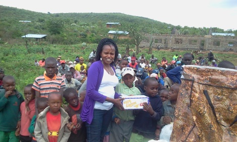 Irene distributes Christmas dinners to children at Lemolo last year.