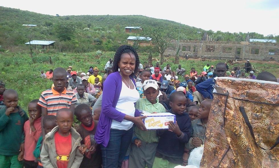 Irene distributes Christmas dinners to children at Lemolo last year.